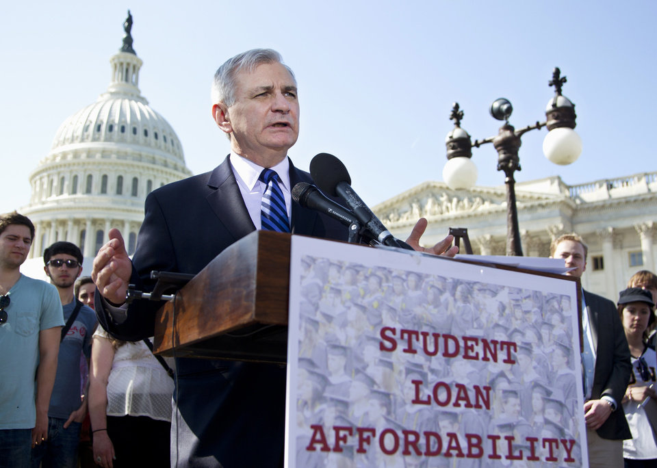 FILE - In this March 13, 2012, file photo Sen. Jack Reed, D-R.I., joins students at a Capitol Hill news conference to announce the collection of over 130,000 letters to Congress to prevent student loan interest rates from doubling this July. The Senate planned a Tuesday May 8, 2012 roll call on a plan, which would extend today's 3.4 percent interest rates on subsidized Stafford loans for another year. (AP Photo/Manuel Balce Ceneta, File)