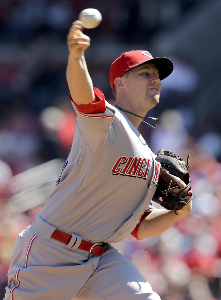 Photo - Cincinnati Reds starting pitcher Mike Leake throws during the first inning of a baseball game against the St. Louis Cardinals Wednesday, April 9, 2014, in St. Louis. (AP Photo/Jeff Roberson)