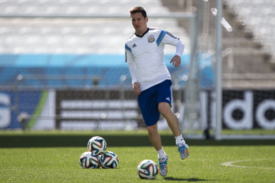 Photo - Argentina's Lionel Messi kicks the ball during a training session at Itaquerao Stadium in Sao Paulo, Brazil, Monday, June 30, 2014. On Tuesday, Argentina faces Switzerland in it's second-round match of the 2014 soccer World Cup. (AP Photo/Dario Lopez-Mills)