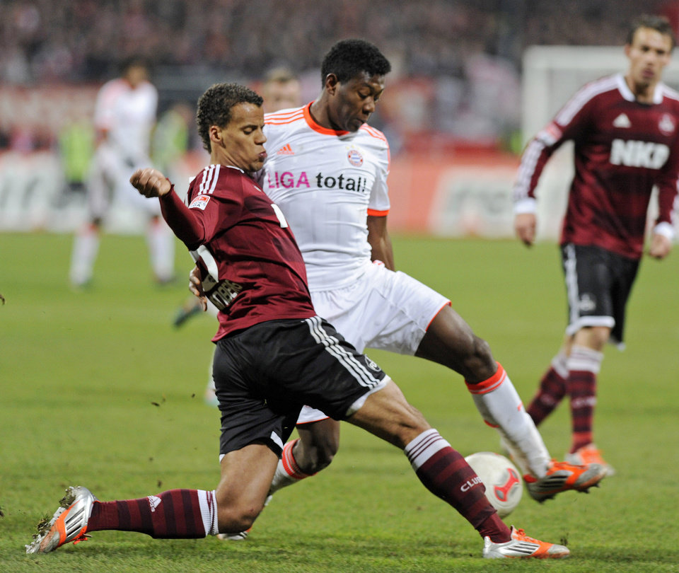 Photo - FILE - In this Nov. 17, 2012, file photo, Nuremberg's Timothy Chandler of the U.S., left, and Bayern's David Alaba of Austria, right, challenge for the ball during a soccer match in Nuremberg, southern Germany.  U.S. team coach Jurgen Klinsman named  Chandler to the team's 30-man preliminary roster on Monday May 12, 2014. (AP Photo/Jens Meyer, File)