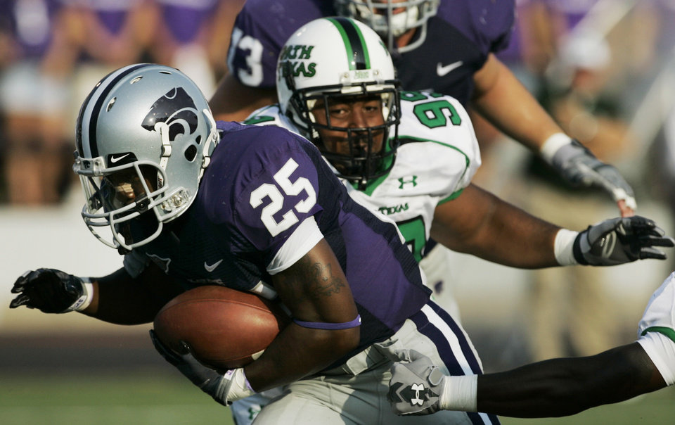 Photo - COLLEGE FOOTBALL: Kansas State running back Keithen Valentine (25) gets past North Texas defenders for a touchdown during the first quarter of a football game in Manhattan, Kan., Saturday, Aug. 30, 2008. (AP Photo/Orlin Wagner) ORG XMIT: KSOW102