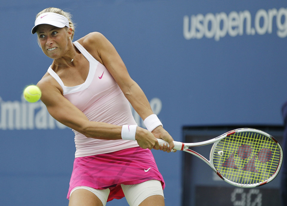 Photo -   Czech Republic's Andrea Hlavackova returns a shot to Serena Williams in the fourth round of play at the 2012 US Open tennis tournament, Monday, Sept. 3, 2012, in New York. (AP Photo/Kathy Willens)