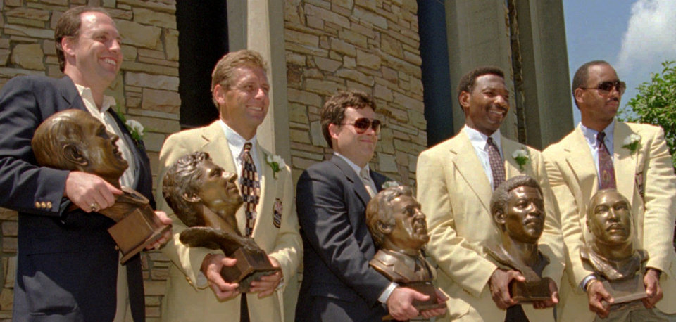 The 1995 Pro Football Hall of Fame inductees pose for a photograph after ceremonies Saturday, July 29, 1995, in Canton, Ohio. They are, from left to right, Henry Jordan, Jr., Steve Largent, Jim Finks Jr., Lee Roy Selmon and Kellen Winslow.