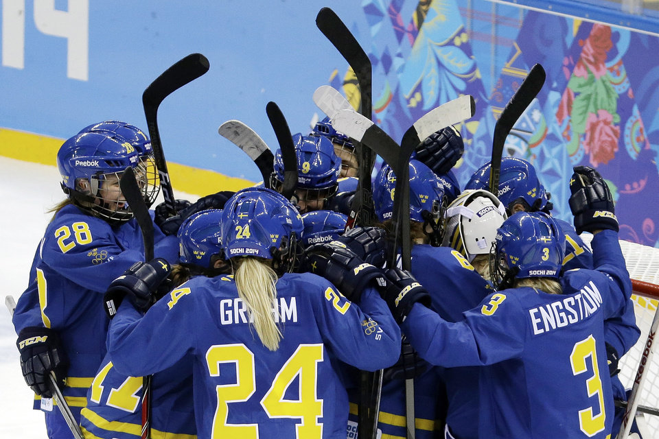 Photo - Team Sweden celebrates their 4-0 victory over Germany during the 2014 Winter Olympics women's ice hockey game at Shayba Arena, Tuesday, Feb. 11, 2014, in Sochi, Russia. (AP Photo/Mark Humphrey