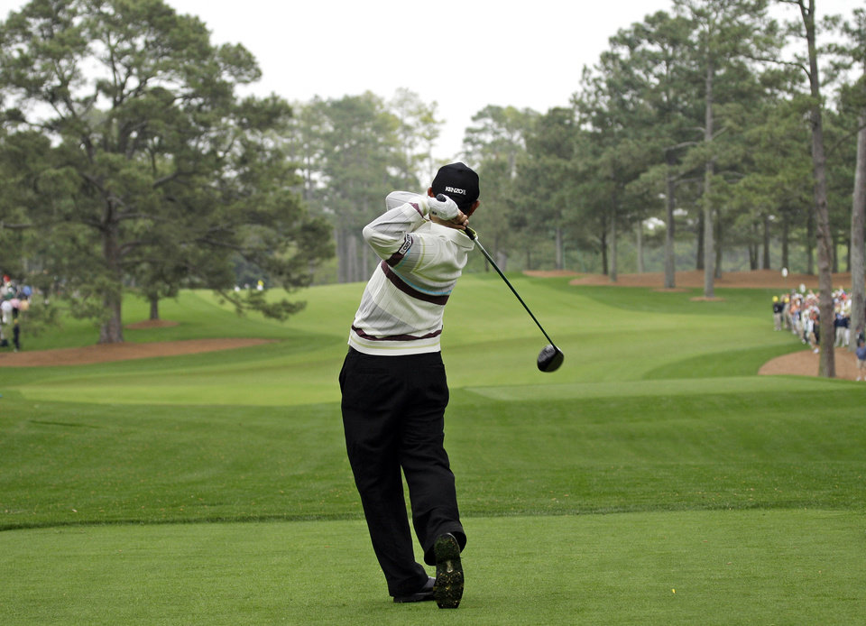 Photo - FILE - In this April 8, 2008, file photo, Toru Taniguchi of Japan tees off on the 17th hole of the Augusta National Golf Club, with the Eisenhower Tree at left, during practice for the 2008 Masters golf tournament in Augusta, Ga. The Eisenhower Tree was removed this weekend because of damage from an ice storm, the Augusta National Golf Club chairman Billy Payne said Sunday, Feb. 16, 2014. The loblolly pine was among the most famous trees in golf and it infuriated one of the club members after whom the tree eventually was named — former President Dwight D. Eisenhower. (AP Photo/David J. Phillip, File)