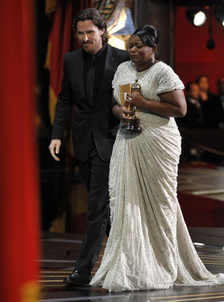 "** EMBARGOED AT THE REQUEST OF THE ACADEMY OF MOTION PICTURE ARTS & SCIENCES FOR USE UPON CONCLUSION OF THE ACADEMY AWARDS TELECAST ** Octavia Spencer leaves the stage after accepting  the Oscar for best actress in a supporting role for ""The Help"" during the 84th Academy Awards on Sunday, Feb. 26, 2012, in the Hollywood section of Los Angeles.  At  left is presenter Christian Bale. (AP Photo/Chris Carlson) ORG XMIT: OSC571"