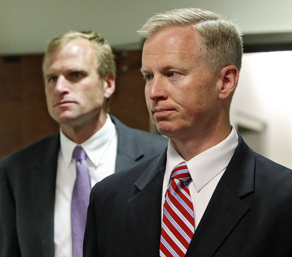 Photo - District Attorney George Brauchler, right, and Assistant District Attorney Mark Hurlbert arrive for a hearing in Centennial, Colo., where Aurora theater shooting suspect James Holmes asked a judge to enter a plea of not guilty by reason of insanity, in Centennial, Colo., on Monday, May 13, 2013. (AP Photo/Ed Andrieski)