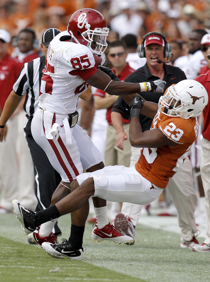 Photo - Oklahoma's Ryan Broyles (85) hits Texas' Carrington Byndom (23) during the Red River Rivalry college football game between the University of Oklahoma Sooners (OU) and the University of Texas Longhorns (UT) at the Cotton Bowl in Dallas, Saturday, Oct. 8, 2011. Oklahoma won 55-17. Photo by Bryan Terry, The Oklahoman