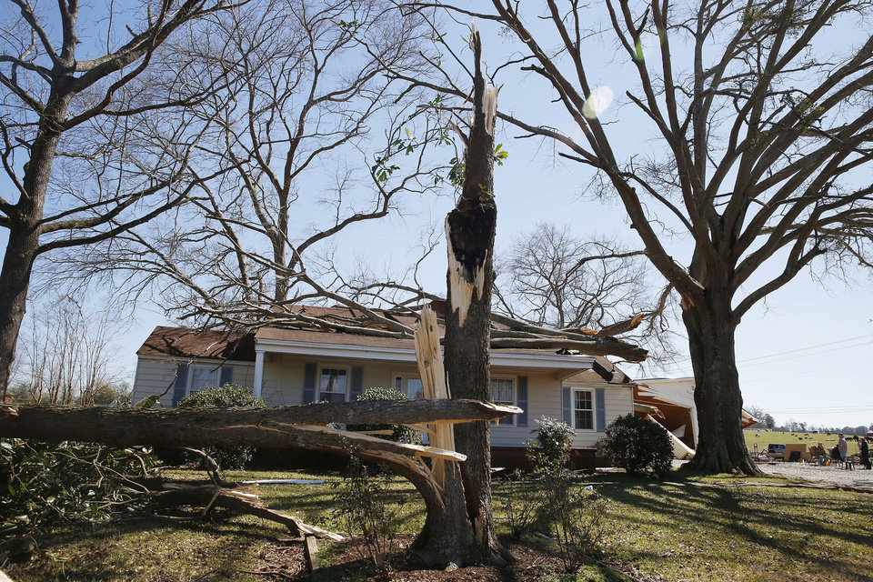 Photo - A home shows damage, on Wednesday, March 2, 2016, from storms that struck Tuesday evening in Bessemer, Ala. Forecasters say a tornado that severely damaged homes and trees in the Birmingham suburb has been determined as an EF2, with winds of between 120 and 125 mph.   (AP Photo/Brynn Anderson)
