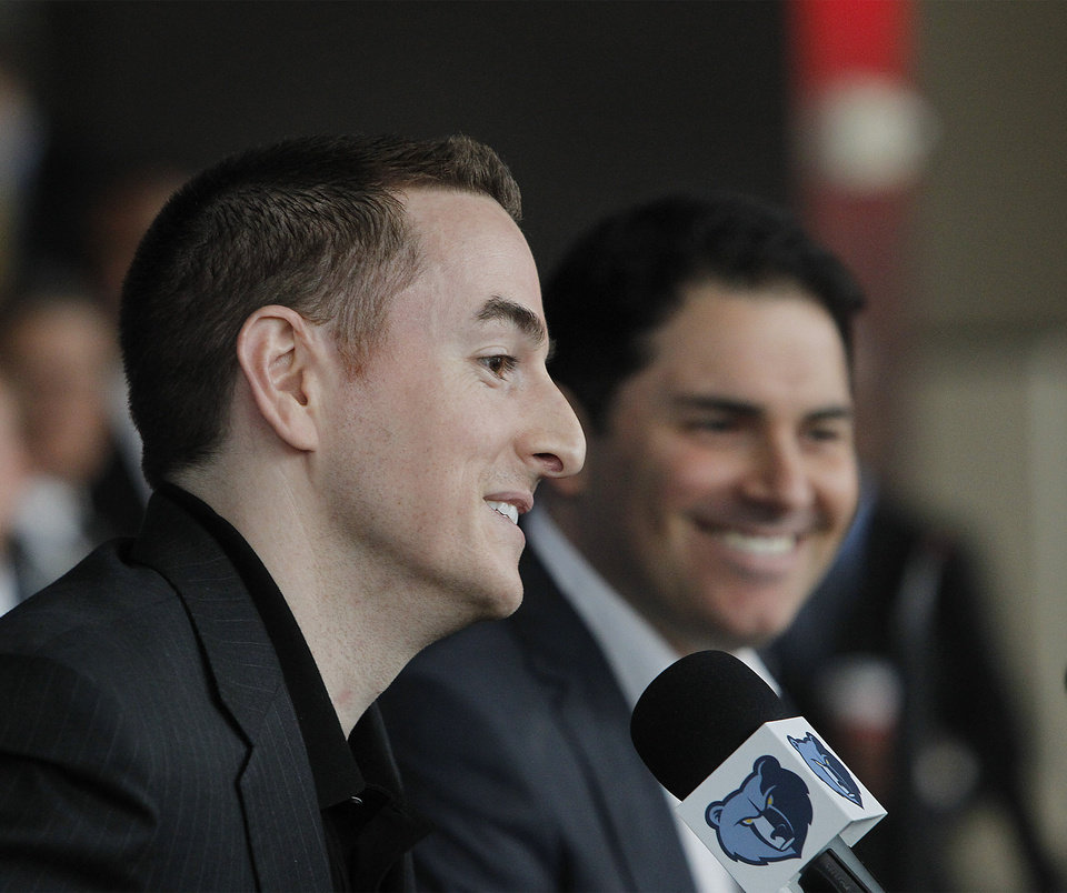 Photo -   Memphis Grizzlies new chairman Robert Pera, left, and new chief executive officer Jason Levien smile at a press conference in Memphis, Tenn., Monday, Nov. 5, 2012. (AP Photo/Lance Murphey)
