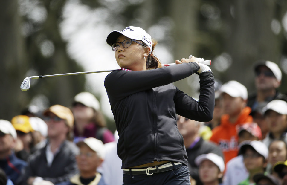Photo - Lydia Ko, of New Zealand, follows her shot from the third tee of the Lake Merced Golf Club during the final round of the Swinging Skirts LPGA Classic golf tournament on Sunday, April 27, 2014, in Daly City, Calif. (AP Photo/Eric Risberg)