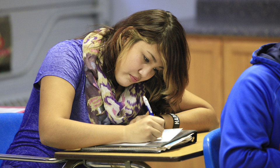 Photo - Sophomore Emily Nanaeto, 15, takes a quiz during Native American language class at Stroud High School. Photo by Paul B. Southerland, The Oklahoman  PAUL B. SOUTHERLAND - PAUL B. SOUTHERLAND