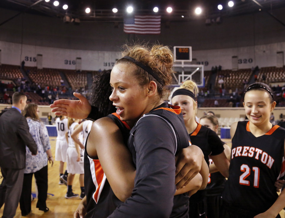 Photo - Chelsea Dungee celebrates her team's state championship with fellow players at the end of the Class 2A Girls State Championship game between Preston and Cordell at Jim Norick Arena at State Fair Park  on Saturday, Mar. 15, 2014.  Preston won,  45-41. Photo by Jim Beckel, The Oklahoman
