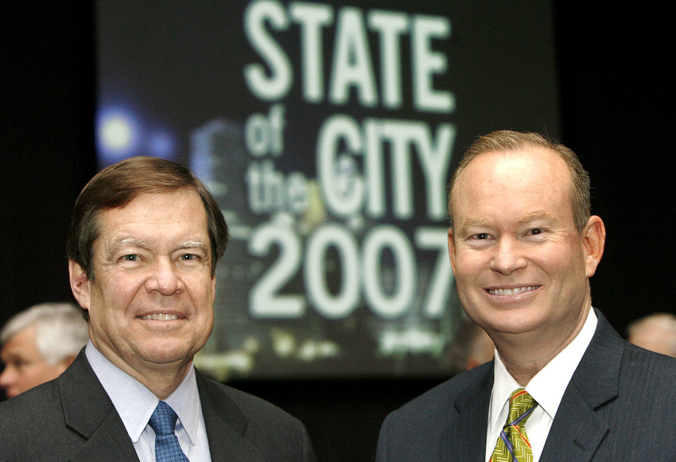 Photo - Oklahoma City Mayor Mick Cornett, right, poses with Greater Oklahoma City Chamber of Commerce President Larry Nichols before the mayor delivered the mayor's annual State of the City address in the Cox Convention Center Wednesday, Jan. 17, 2007.    By Jim Beckel, The Oklahoman.  ORG XMIT: KOD