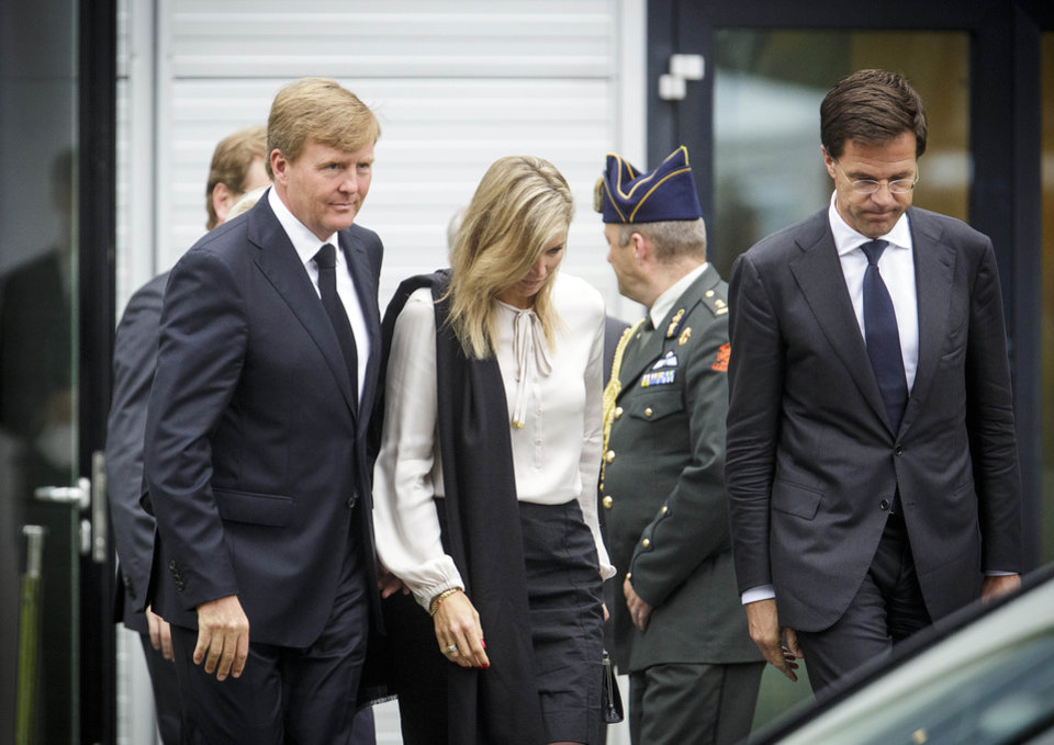 Photo - Dutch King Willem-Alexander, left, Queen Maxima, center, and Dutch Prime Minister Mark Rutte, far right, leave a meeting in Nieuwegein, near the central city of Utrecht, Netherlands, Monday, July 21, 2014. Relatives of Dutch victims killed in the downing of Malaysia Airlines Flight 17 were meeting Monday afternoon with their king, queen and prime minister amid growing anger at the treatment of their loved ones' bodies by pro-Russian rebels in Ukraine. In an unusual move that underscored the severity of the national trauma, a somber King Willem-Alexander gave a brief televised address to his country after meeting grieving relatives.