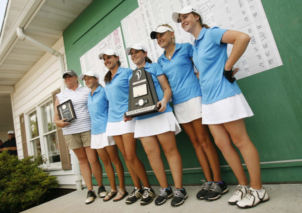 The Edmond North girls team pose with their runner-up trophy held by individual winner Allison Sell (middle) at the Class 6A Girls State Golf tournamnet at Muskogee Country Club in Muskogee, Okla. taken on May 3, 2012. JAMES GIBBARD/Tulsa World