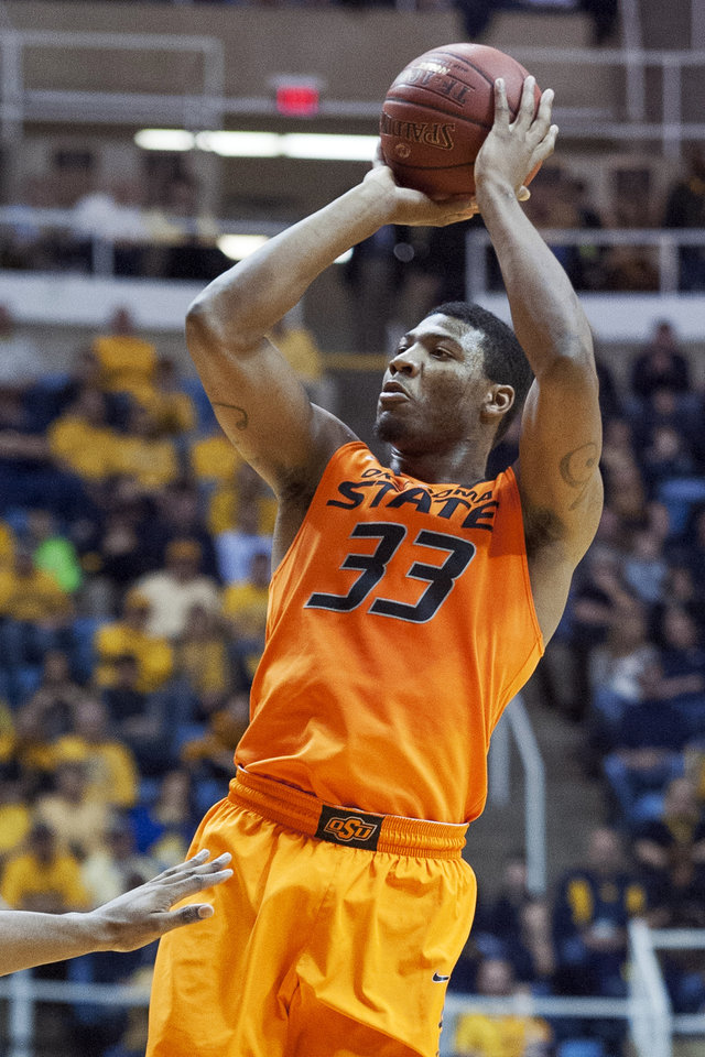 Oklahoma State's Marcus Smart (33) looks to shoot during the first half of an NCAA college basketball game against West Virginia, Saturday, Jan. 11, 2014, in Morgantown, W.Va. (AP Photo/Andrew Ferguson)