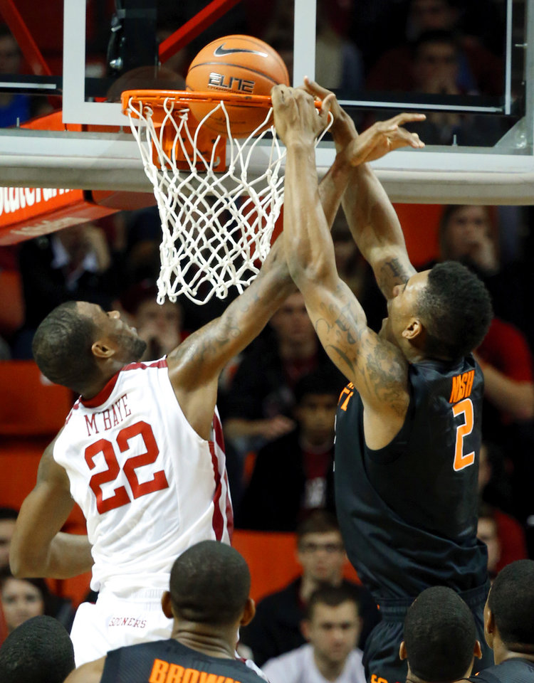 Photo - Cowboy's Le'Bryan Nash (2) scores guarded by Sooner's Amath M'Baye (22) during the second half as the University of Oklahoma Sooners (OU) defeat  the Oklahoma State Cowboys (OSU) 77-68  in NCAA, men's college basketball at The Lloyd Noble Center on Saturday, Jan. 12, 2013  in Norman, Okla. Photo by Steve Sisney, The Oklahoman