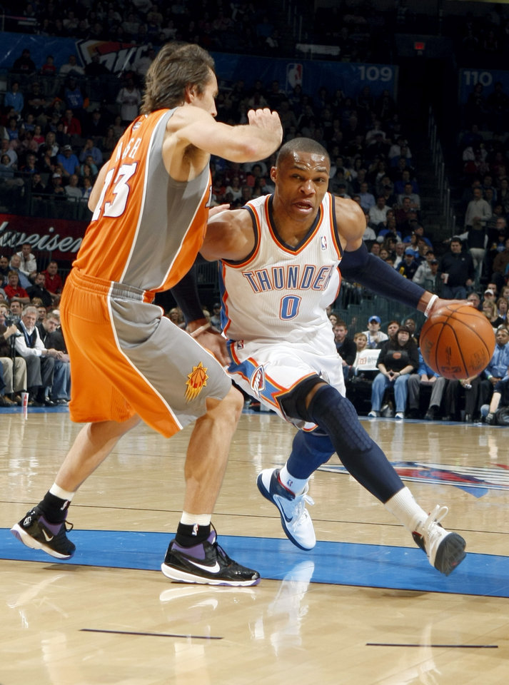 Oklahoma City\'s Russell Westbrook (0) tries to get past Phoenix\'s Steve Nash (13) during the NBA game between the Oklahoma City Thunder and the Phoenix Suns, Sunday, March 6, 2011, the Oklahoma City Arena. Photo by Sarah Phipps, The Oklahoman.