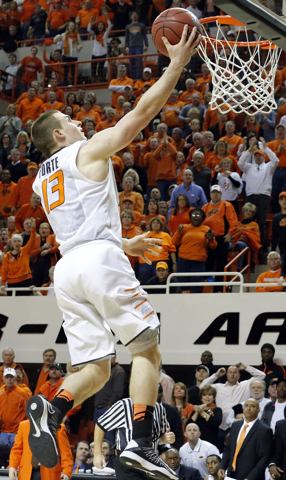 Photo - Oklahoma State's Phil Forte (13) shoots a lay up during the Bedlam men's college basketball game between the Oklahoma State University Cowboys and the University of Oklahoma Sooners at Gallagher-Iba Arena in Stillwater, Okla., Saturday, Feb. 16, 2013. Photo by Sarah Phipps, The Oklahoman