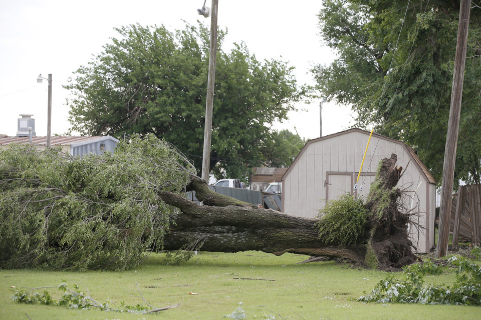 Photo - Tornado damage along State Highway 66 in El Reno, Okla., Sunday, May 26, 2019. [Bryan Terry/The Oklahoman]