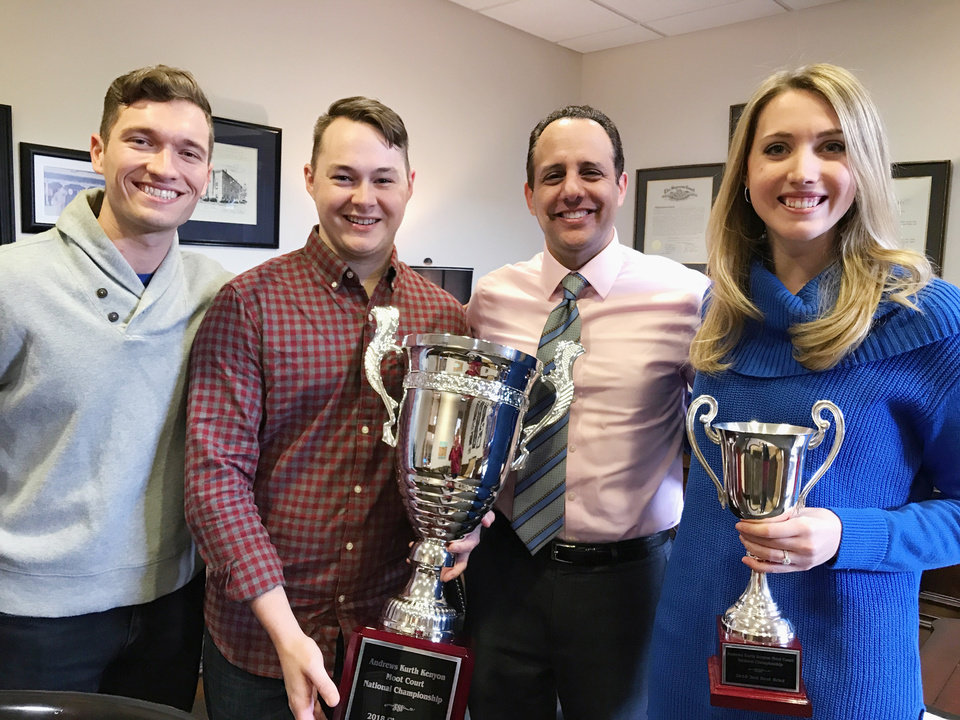 Photo - The team of third-year law students from the University of Oklahoma College of Law won first place in the 2018 Andrews Kurth Kenyon Moot Court National Championship held Jan. 25-27 in Houston. Ty Schoenhals, Connor Bourland and Kellie Laughlin with OU College of Law Dean Joseph Harroz Jr.
