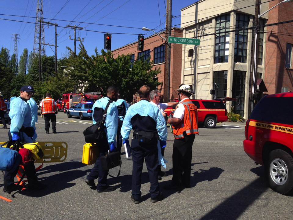 Photo - Emergency personnel arrive on the scene near a shooting on the Seattle Pacific University campus Thursday, June 5, 2014, in Seattle. The university posted online Thursday that
