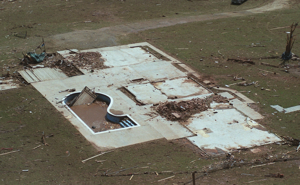 MAY 3, 1999 TORNADO: TORNADO DAMAGE: A home completely carried away in NW Moore, near Westmoore School. All that's left is foundation.