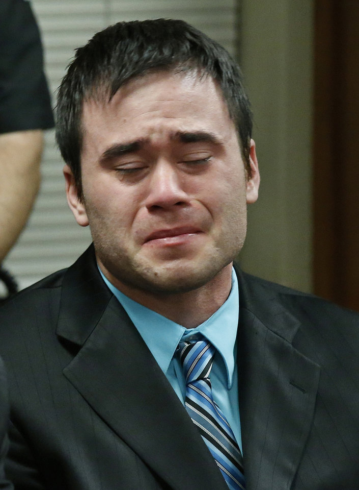 Photo - Daniel Holtzclaw cries as the verdicts are read in his trial in Oklahoma City, Thursday, Dec. 10, 2015. Holtzclaw, a former Oklahoma City police officer, was facing dozens of charges alleging he sexually assaulted 13 women while on duty. Holtzclaw was found guilty on a number of counts. (AP Photo/Sue Ogrocki, Pool)