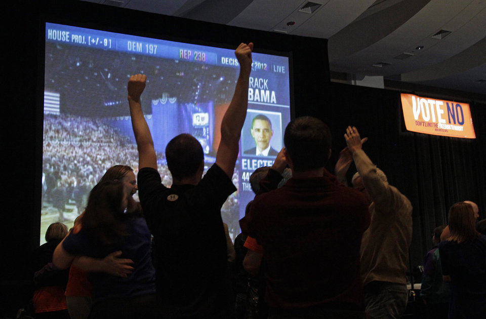 Photo -   Opponents of the gay marriage amendment on the Minnesota celebrate after President Barack Obama was named projected winner of the race for president during an election night party,Tuesday, Nov. 6, 2012 in St. Paul, Minn. (AP Photo/Jim Mone)