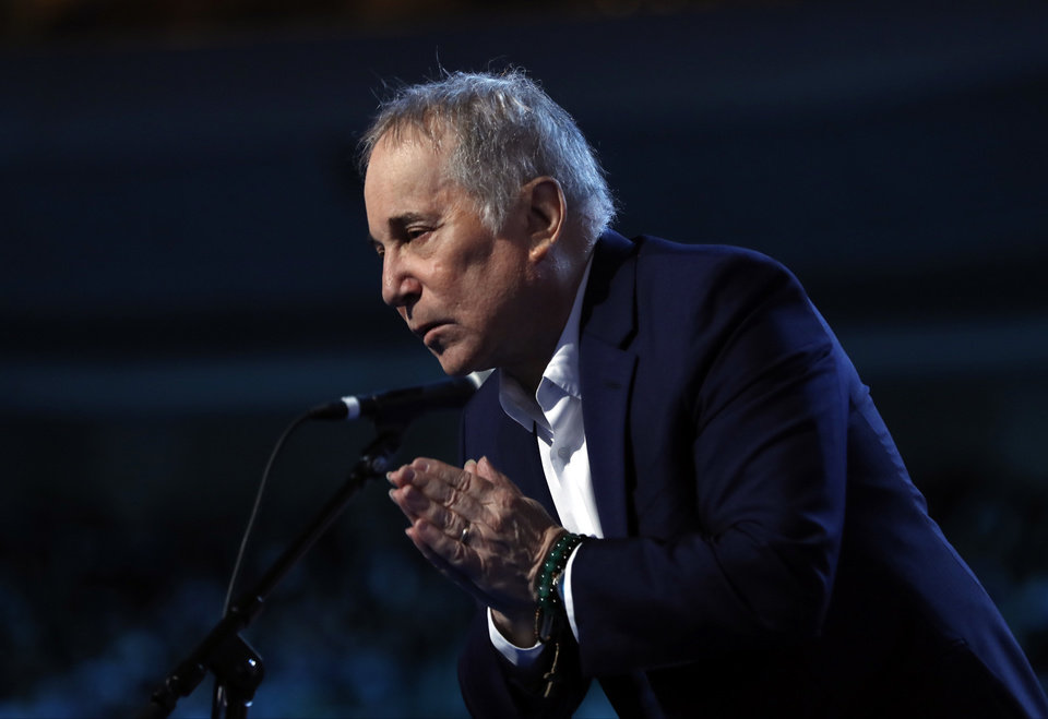 Photo - Paul Simon performs during the first day of the Democratic National Convention in Philadelphia , Monday, July 25, 2016. (AP Photo/Carolyn Kaster)