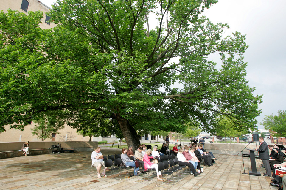 First Church's the Rev. Kirk Norman prays during a 2009 National Day of Prayer Service at the Oklahoma City National Memorial under the Survivor Tree in Oklahoma City.  Photo by Steve Gooch, The Oklahoman Archives <strong>Steve Gooch - The Oklahoman</strong>