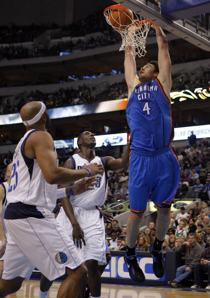 Photo - Oklahoma City's Nick Collison (4) dunks the ball during the preseason NBA game between the Dallas Mavericks and the Oklahoma City Thunder at the American Airlines Center in Dallas, Sunday, Dec. 18, 2011. Photo by Sarah Phipps, The Oklahoman