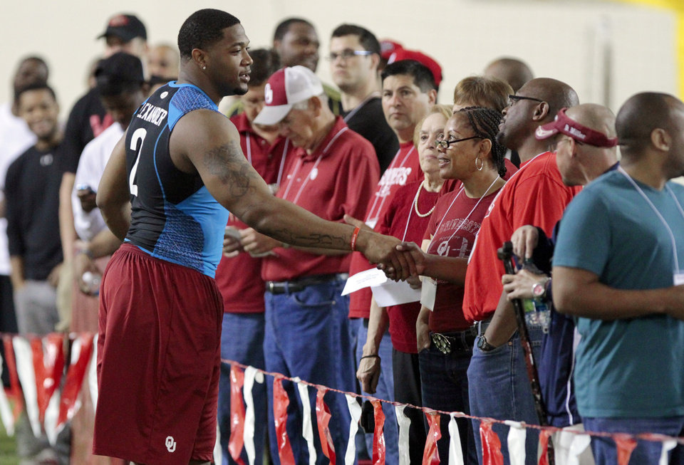 Frank Alexander talks with fans at the University of Oklahoma (OU)'s football team's annual Pro Day workouts on Wednesday, March 14, 2012, in Norman, Okla.  Photo by Steve Sisney, The Oklahoman