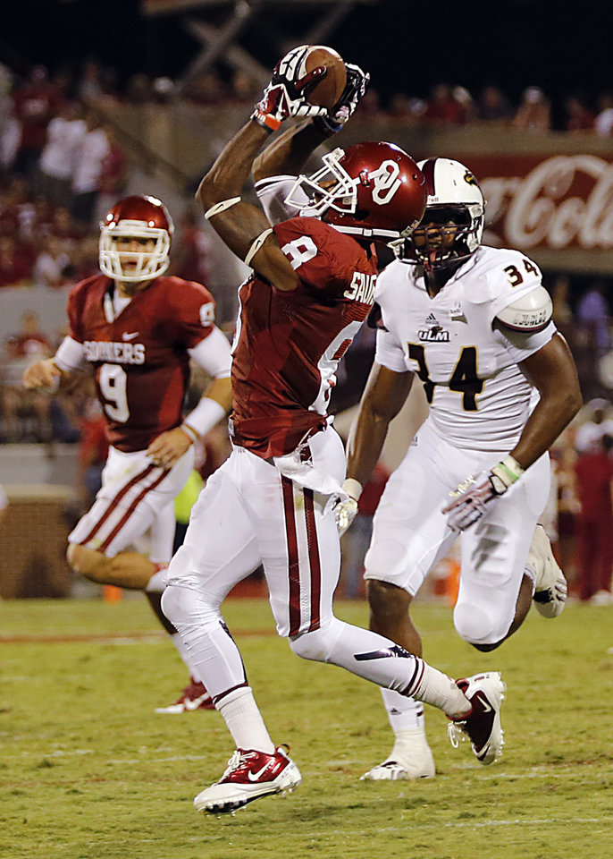 Oklahoma\'s Jalen Saunders (8) makes a catch in front of Louisiana Monroe\'s Michael Johnson (34) during the college football game between the University of Oklahoma Sooners (OU) and the University of Louisiana Monroe Warhawks (ULM) at the Gaylord Family Memorial Stadium on Saturday, Aug. 31, 2013 in Norman, Okla. Photo by Chris Landsberger, The Oklahoman