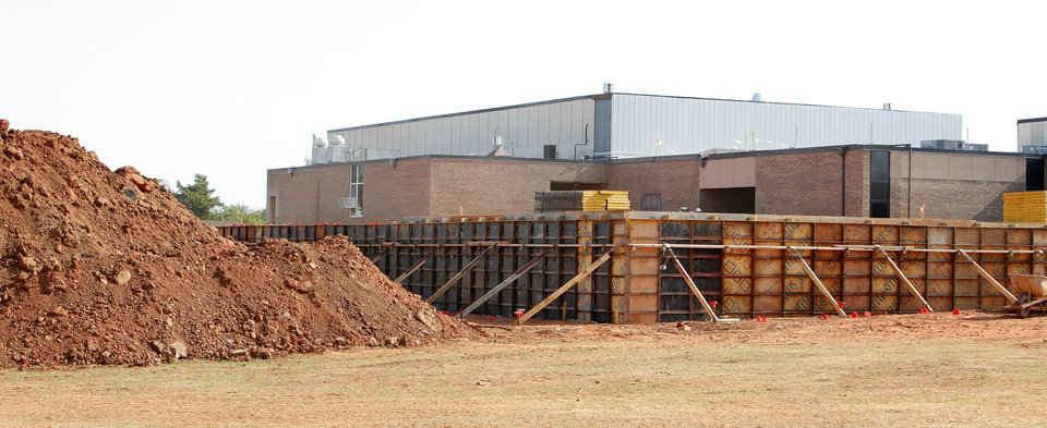 Photo - Construction on a new building is shown behind Del City Elementary School in Del City. Photos by Paul B. Southerland, The Oklahoman