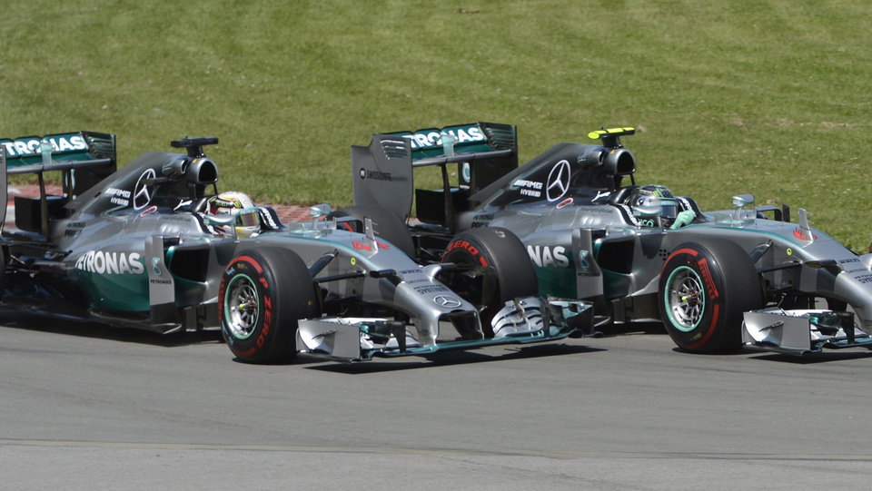 Photo - Mercedes driver Nico Rosberg, right, from Germany, leads teammate Lewis Hamilton of Great Britain at the start of the Canadian Grand Prix, Sunday, June 8, 2014 in Montreal. (AP Photo/The Canadian Press, Ryan Remiorz)