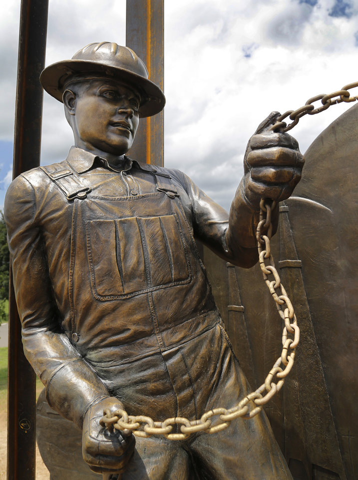 """Photo -  A closeup of one of the oilfield workers in Edmond's newest public art piece, """"West Edmond Oil Field."""" PHOTO BY JIM BECKEL, THE OKLAHOMAN   Jim Beckel -"""