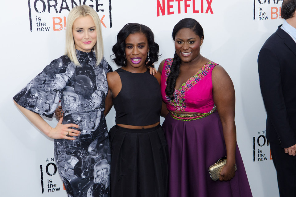 Photo - FILE - In this May 15, 2014, file photo, Taylor Schilling, from left, Uzo Aduba and Danielle Brooks attend Netflix's