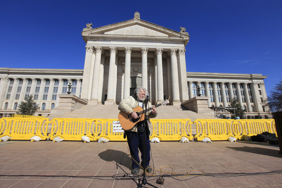 Bob Moore, Slaughterville, sings a song about marijuana in support of Senate Bill 2116 to legalize marijuana during a rally on the south steps of the state Capitol in Oklahoma City Wednesday, Feb. 12, 2014. Supporters converged on the state Capitol to personally lobby their legislators to reform Oklahoma\'s strict marijuana laws during