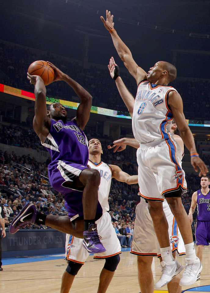 Photo - Oklahoma City's Russell Westbrook, right, and Thabo Sefolosha defend Sacramento's Tyreke Evans during the NBA basketball game between the Oklahoma City Thunder and the Sacramento Kings at the Ford Center in Oklahoma City, Tuesday, March 2, 2010.  Photo by Bryan Terry, The Oklahoman