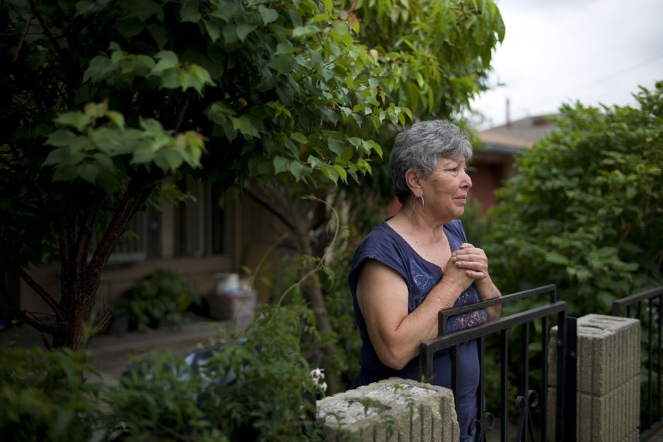 Photo - Rita Salazar, who lives across the street from an apartment building where suspect Isidro Garcia lived, stands in her garden on Thursday, May 22, 2014, in Bell Gardens, Calif. A woman who disappeared a decade ago as a 15-year-old reunited recently with her mother, who convinced her to go to authorities to report that she had been kidnapped and raped by Garcia who is now her husband and father of her daughter. (AP Photo/Jae C. Hong)