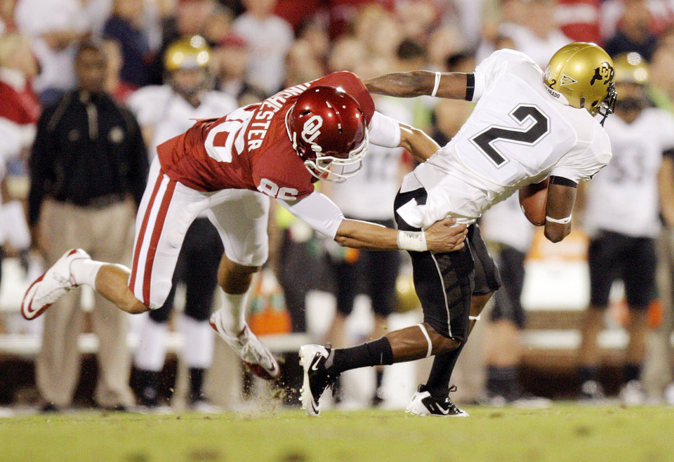 Photo - OU's James Winchester (86) stops Travon Patterson (2) of Colorado on a punt return in the first quarter during the college football game between the University of Oklahoma (OU) Sooners and the University of Colorado Buffaloes at Gaylord Family-Oklahoma Memorial Stadium in Norman, Okla., Saturday, October 30, 2010. Photo by Nate Billings, The Oklahoman