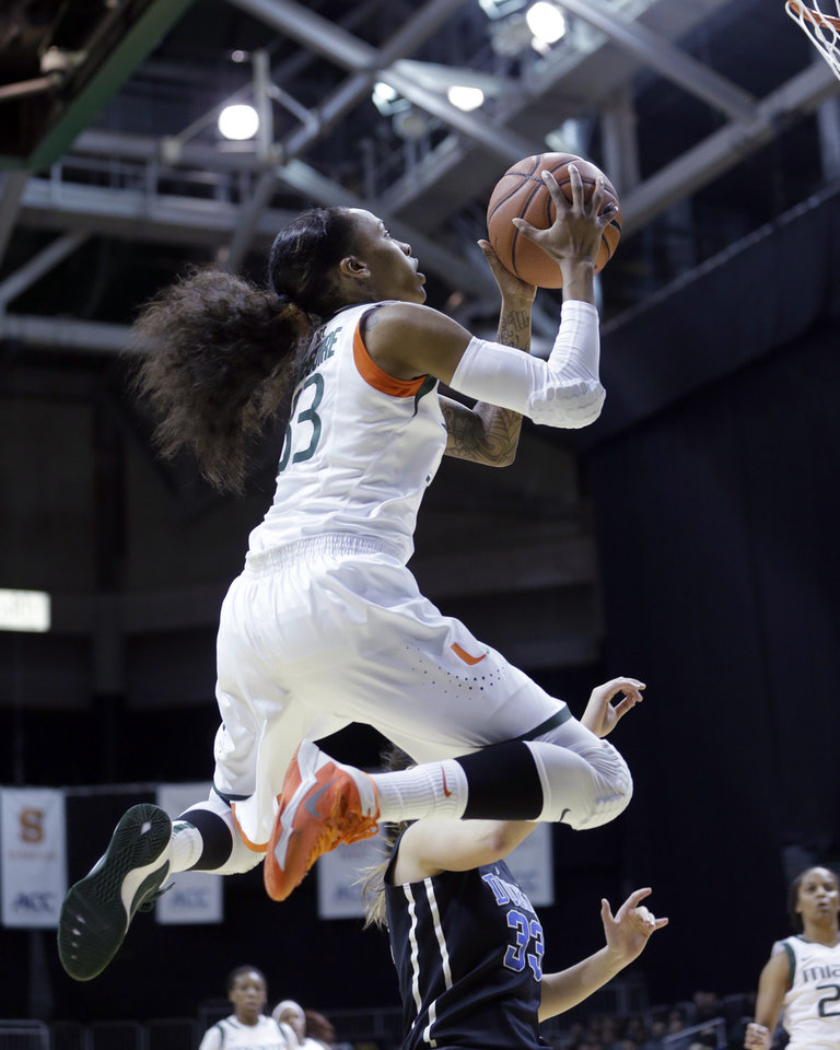 Photo - Miami Hurricanes guard Suriya McGuire (33) goes to the basket against the Duke Blue Devils during the first half of an NCAA college basketball game in Coral Gables, Fla., Thursday, Jan. 30, 2014. (AP Photo)