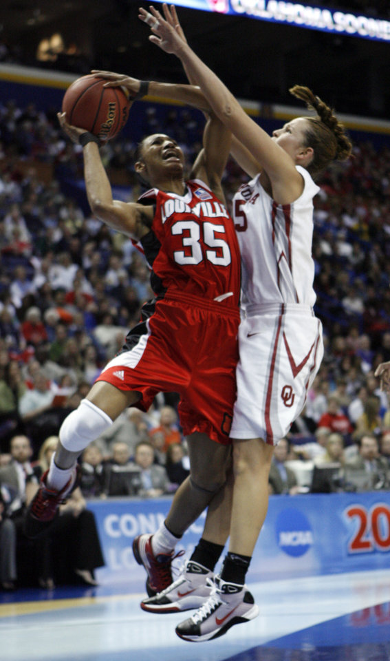 Photo - Whitney Hand defends Angel McCoughtry (35) in the first half as the University of Oklahoma plays Louisville at the 2009 NCAA women's basketball tournament Final Four in the Scottrade Center in Saint Louis, Missouri on Sunday, April 5, 2009. 