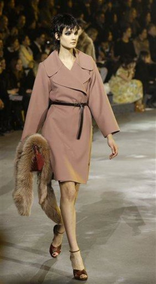 A model walks holding a fur during the Marc Jacobs Fall 2013 fashion show at Fashion Week in New York, Thursday, Feb. 14, 2013.  (AP Photo/Kathy Willens)
