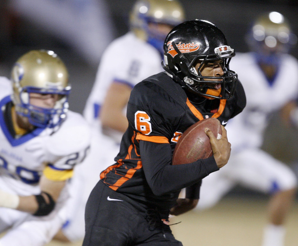 Douglass\' Shon Bridges runs during a high school football playoff game in Oklahoma City, Friday, Nov. 19, 2010. Photo by Bryan Terry, The Oklahoman