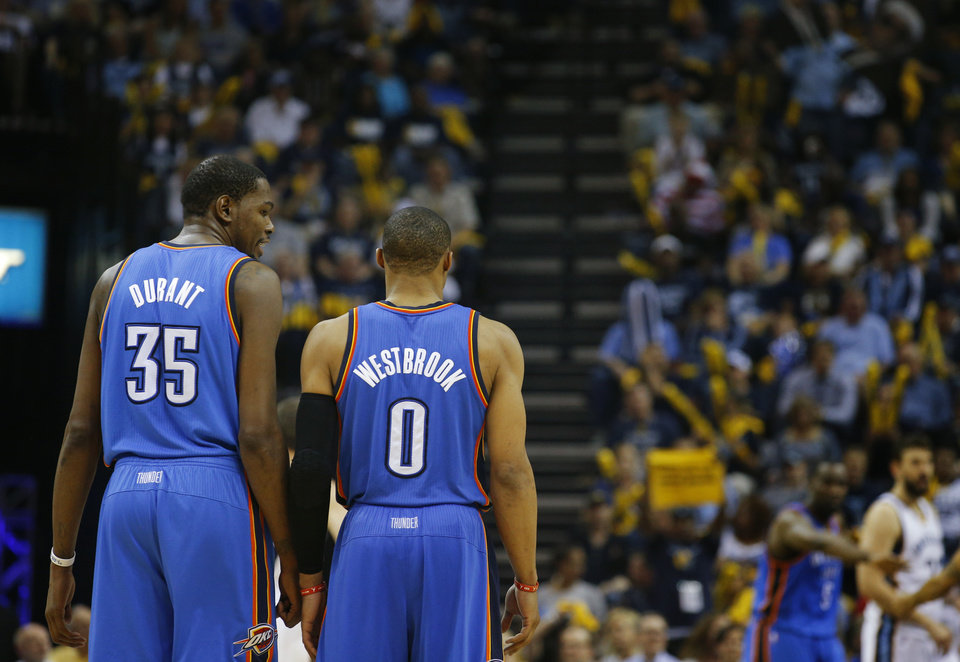 Oklahoma City's Kevin Durant (35) talks with Oklahoma City's Russell Westbrook (0) during Game 3 in the first round of the NBA playoffs between the Oklahoma City Thunder and the Memphis Grizzlies at FedExForum in Memphis, Tenn., Thursday, April 24, 2014. Memphis won 98-95. Photo by Bryan Terry, The Oklahoman