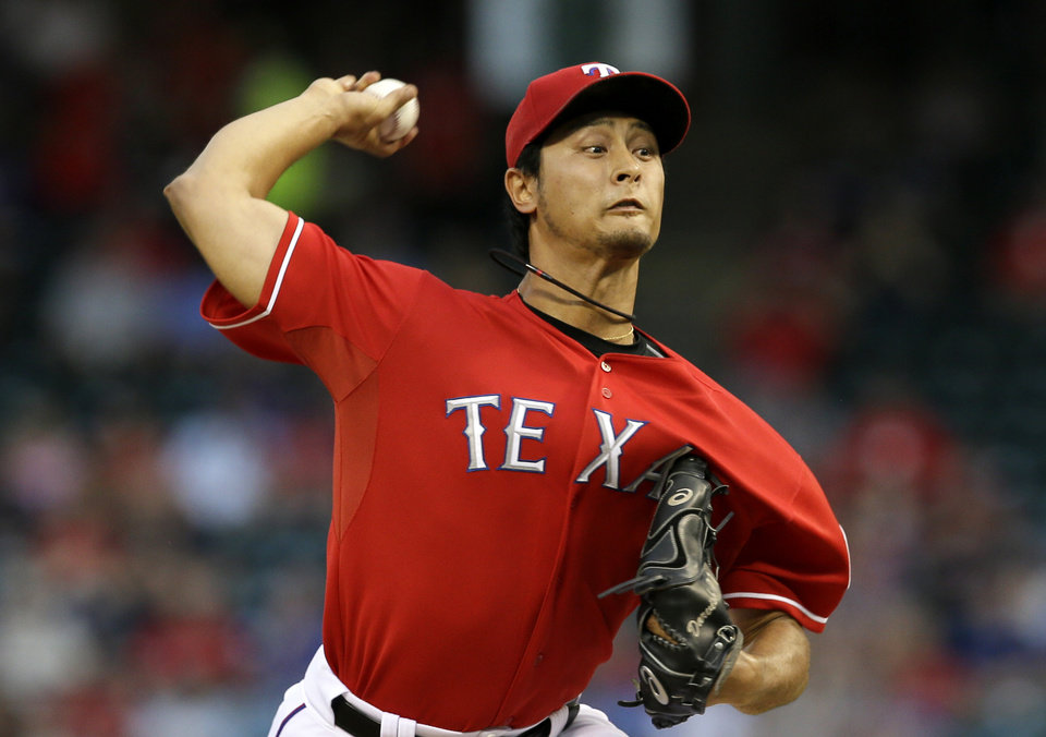 Photo - Texas Rangers starting pitcher Yu Darvish (11), of Japan, works against the Pittsburgh Pirates in the first inning of a baseball game, Monday, Sept. 9, 2013, in Arlington, Texas. (AP Photo/Tony Gutierrez)