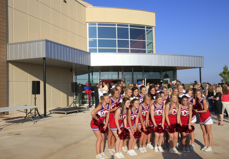 Cheerleaders pose for a group photo after Oklahoma Christian School's dedication of its new high school building on Monday. <strong>David McDaniel - The Oklahoman</strong>